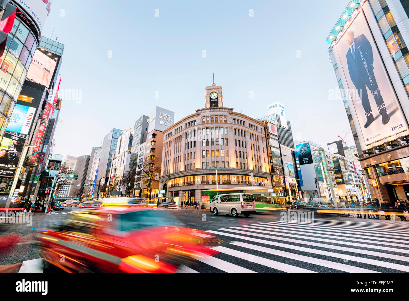 Tokyo, Japan - January 18, 2015:  Ginza shopping district at rush hour in Tokyo, with the iconic Ginza Wako building - Stock Image