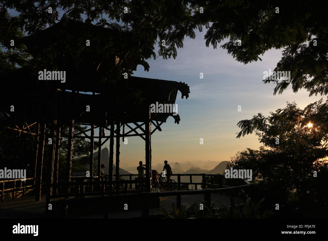 Rio de Janeiro, Brazil, 14th February. People enjoy the sunrise at Vista Chinesa (Chinese Belvedere) in Tijuca Forest Stock Photo