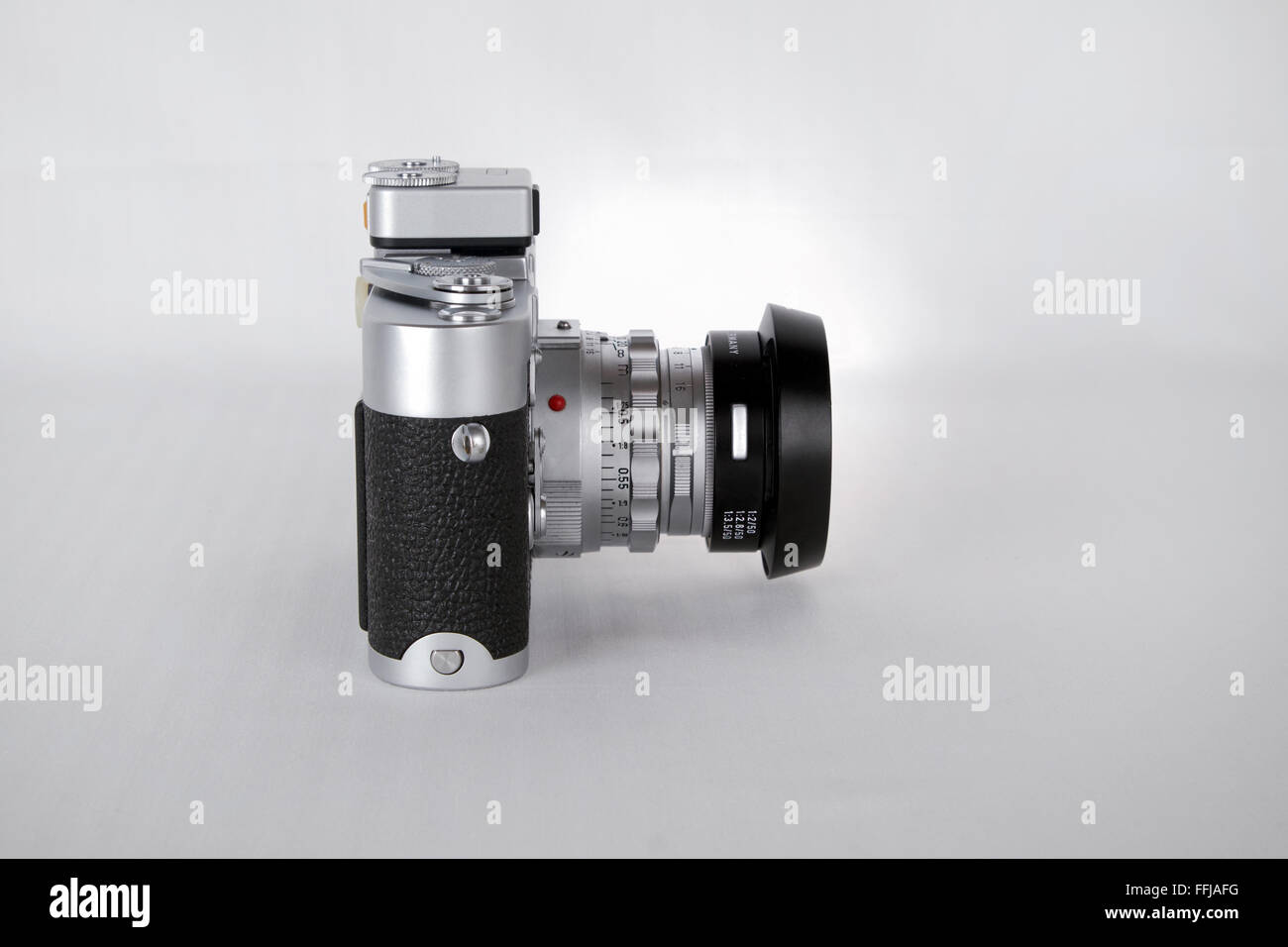 vintage Leica M3 film camera against a white background. Stock Photo