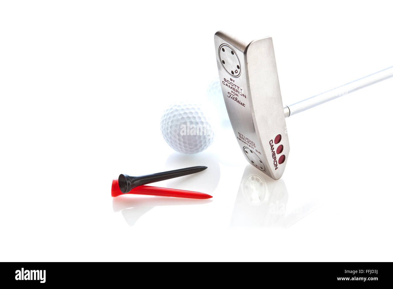 Scotty Cameron Putter with Golf Ball and Tees on a White Background - Stock Image