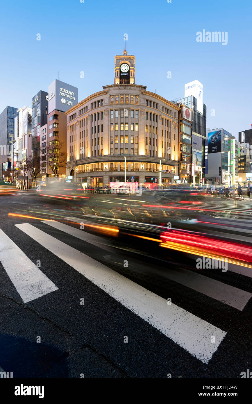 Tokyo, Japan - January 18, 2015:  Ginza shopping district at rush hour in Tokyo, with the iconic Ginza Wako building. - Stock Image