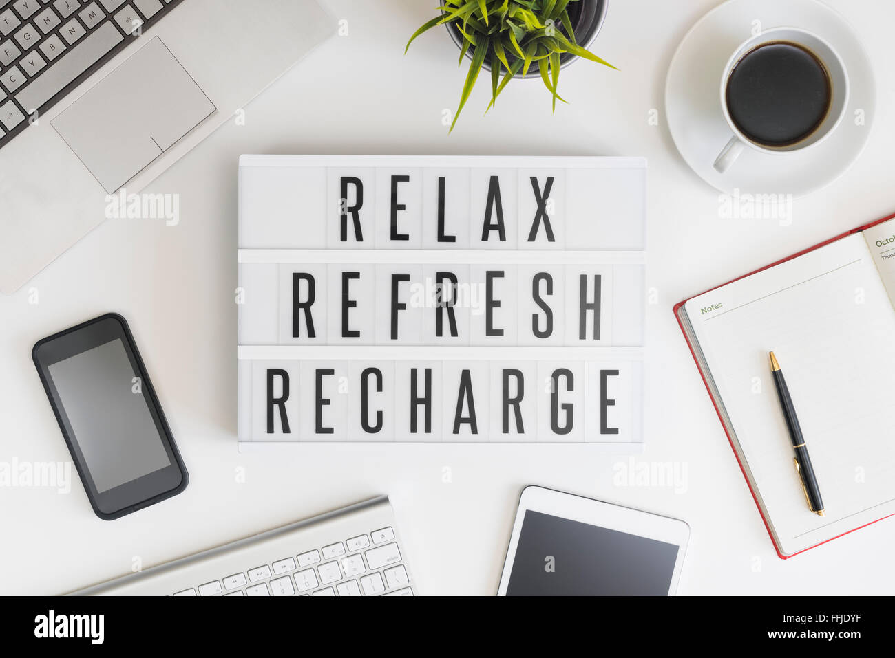 Relax, refresh and recharge in office - Stock Image