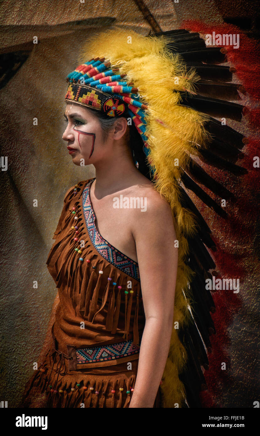Thai girl in traditional Native American Indian costume at the Burapha biker festival Pattaya Thailand S. E. Asia - Stock Image