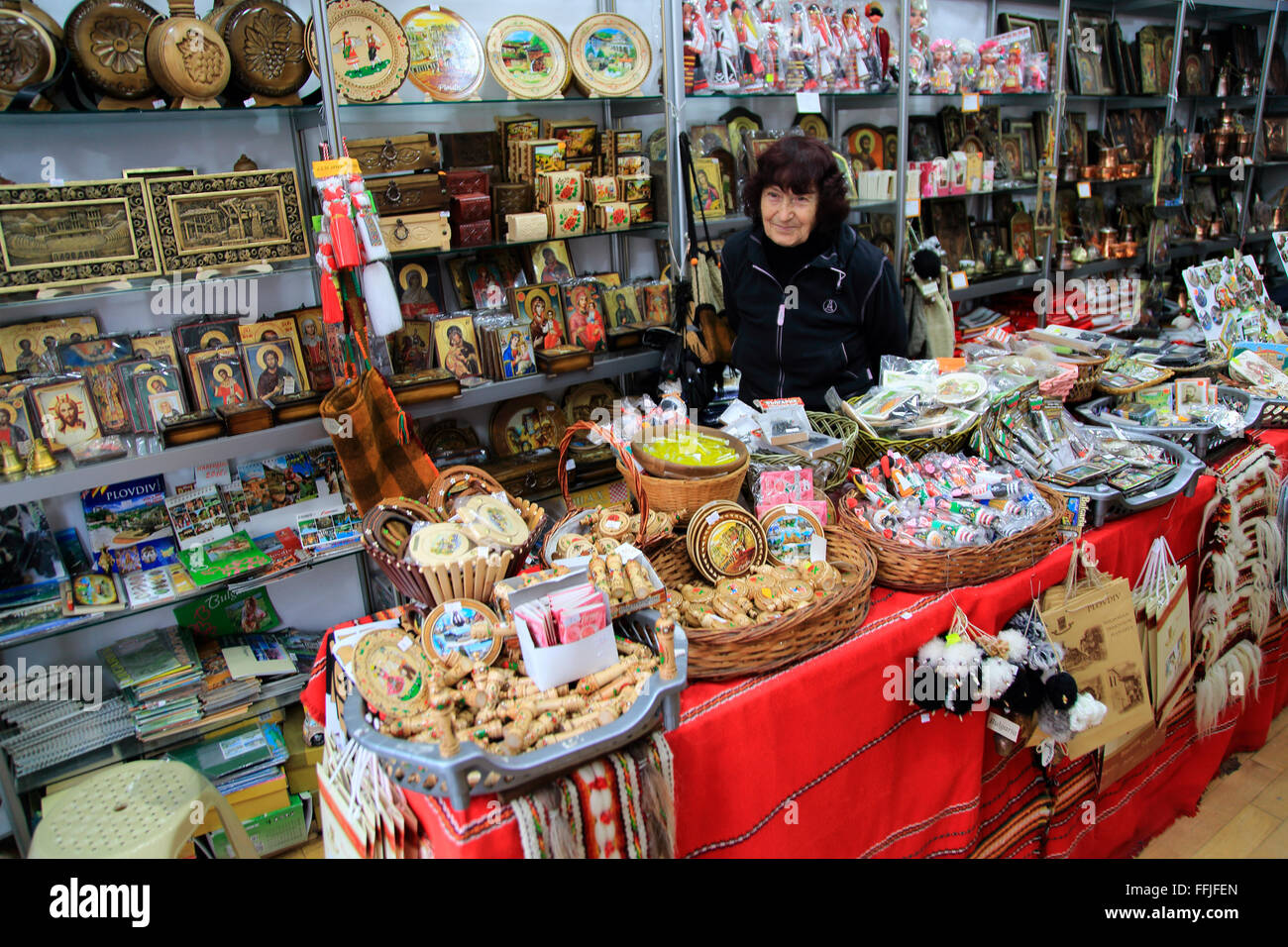 Woman shopkeeper standing in her souvenir gift shop, Plovdiv, Bulgaria, eastern Europe - Stock Image