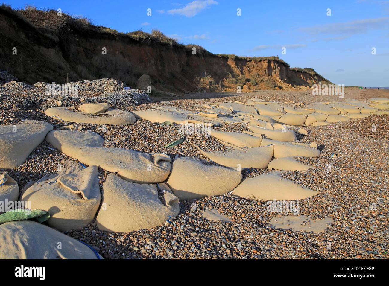 Sacks containing shingle form coastal defences at Thorpeness, Suffolk, England, UK Stock Photo