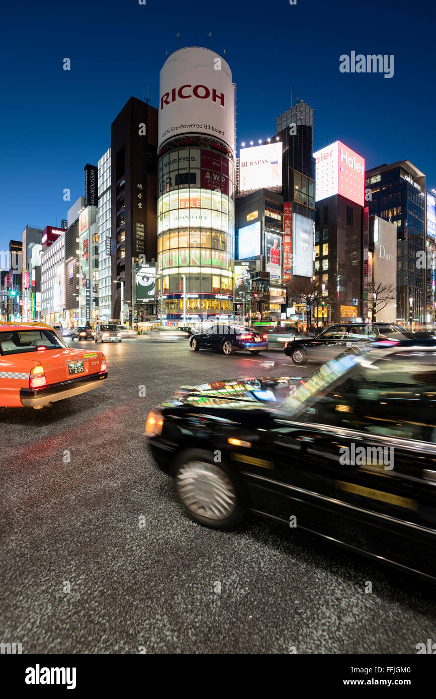 Tokyo, Japan - January 18, 2015:  Ginza shopping district at rush hour in Tokyo with iconic  Sanaa Building . Stock Photo