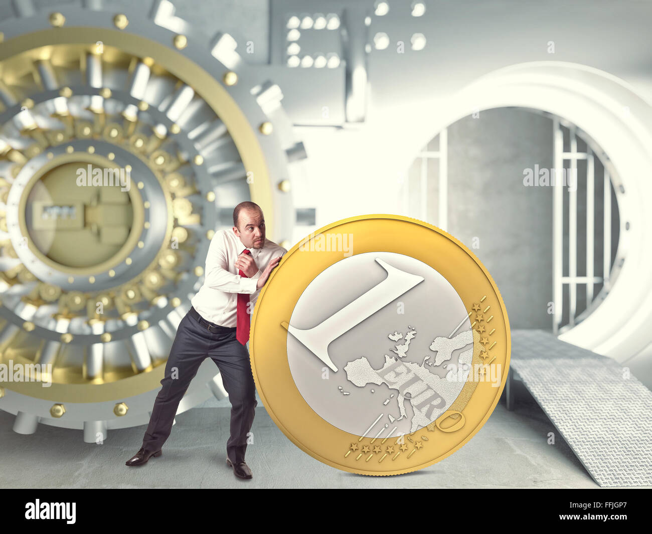 businessman push huge euro coin in bank vault - Stock Image