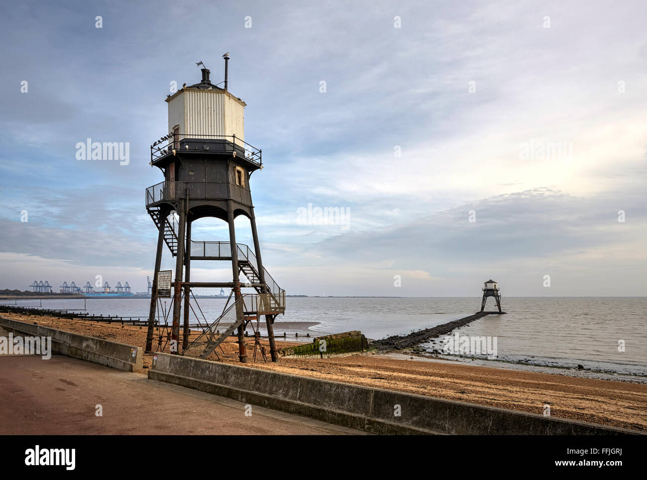 Essex Dovercourt High and Low lighthouses with Felixstowe in the background erected by Trinity House to navigate - Stock Image