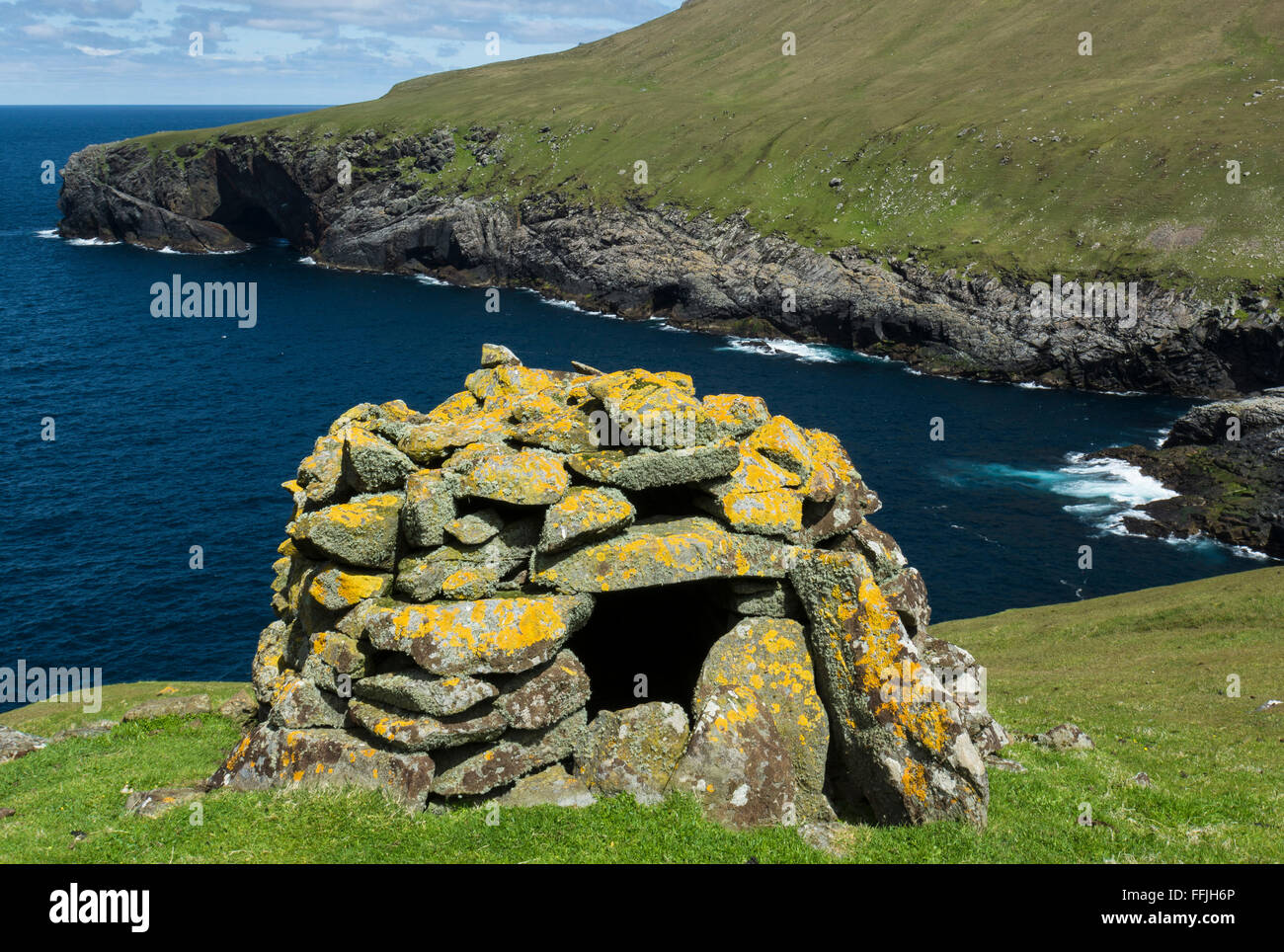 cleat cleit covered in lichen on st kilda a food store on cliff top - Stock Image