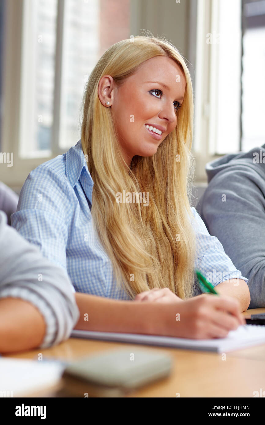 Happy young college student learning in class Stock Photo