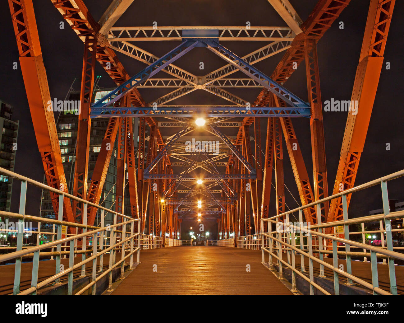 On the rotating, former railway, bridge at night, Salford Quays, Manchester - Stock Image