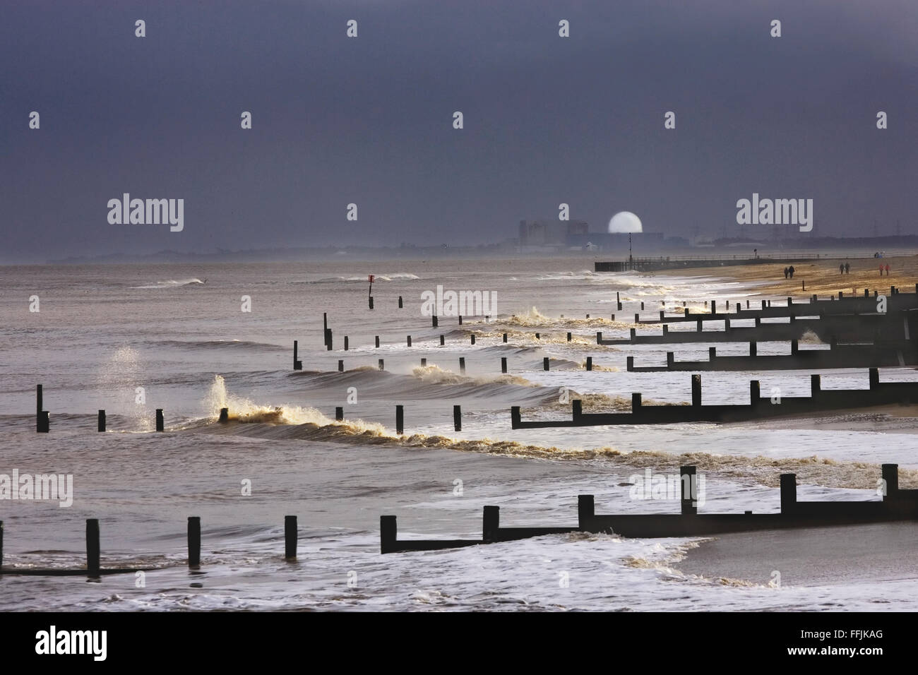 Sizewell Nuclear Power station, groynes photographed from Southwold, with considerable wave action and spray, in - Stock Image