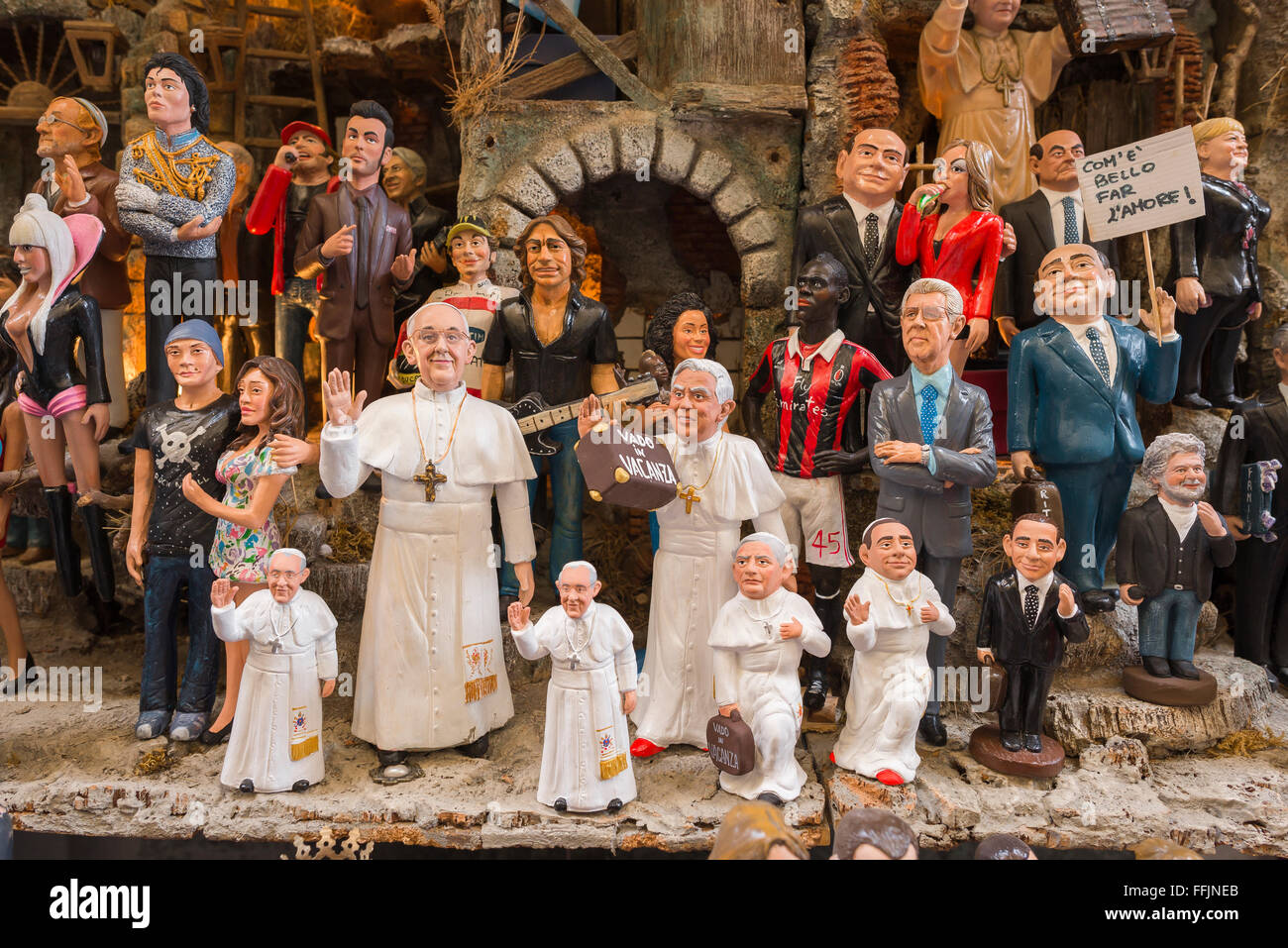 Naples crib shop, a group of colourful celebrity figurines crafted by artisans in a crib shop in the Via San Gregorio - Stock Image