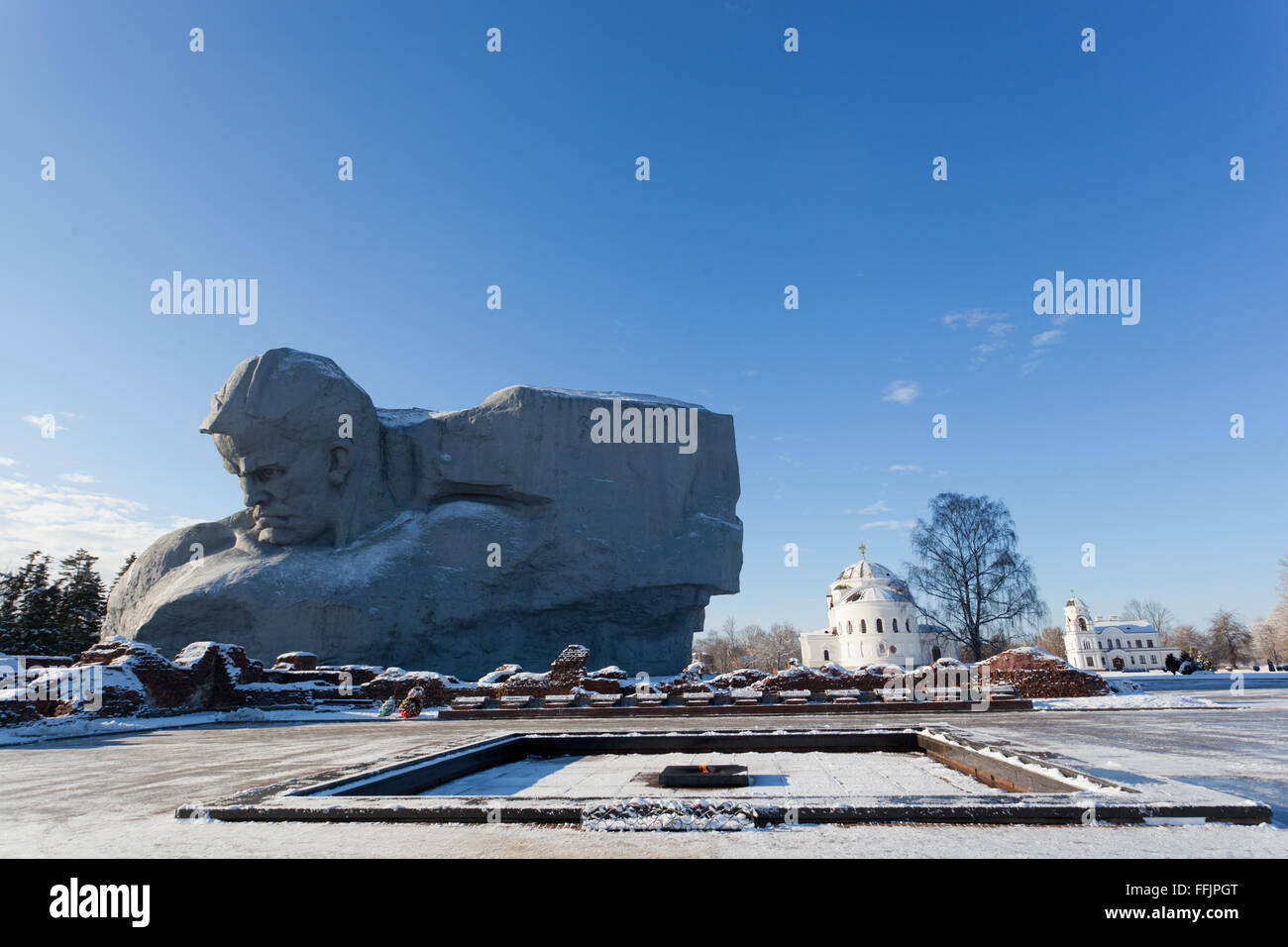 Monument Courage and an eternal flame in Brest fortress in winter day, Belarus - Stock Image