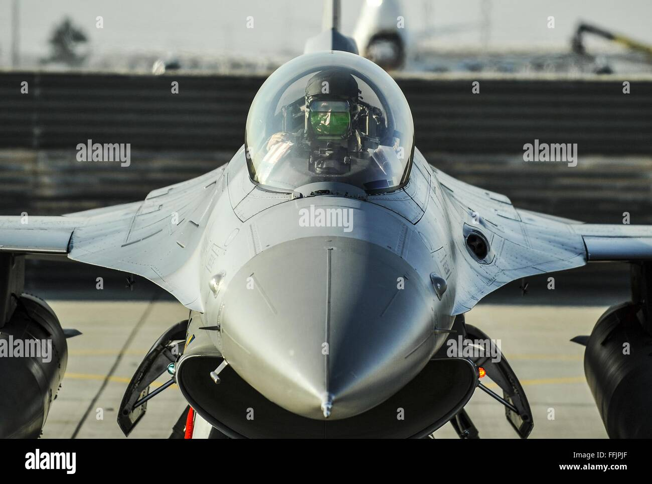 U.S. Air Force pilot Lt. Col. Thomas Wolfe performs preflight checks on an F-16 Fighting Falcon aircraft as he prepares - Stock Image