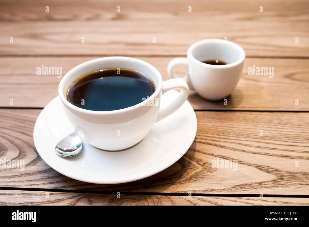 Americano on a wood table, espresso - Stock Image