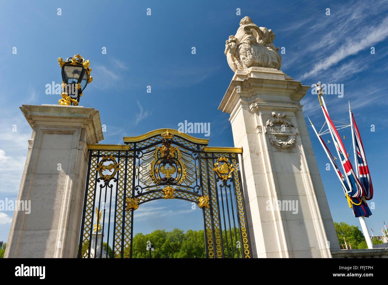 A steel gate ornate with golden decorations near Buckingham Palace, London, United Kingdom. - Stock Image