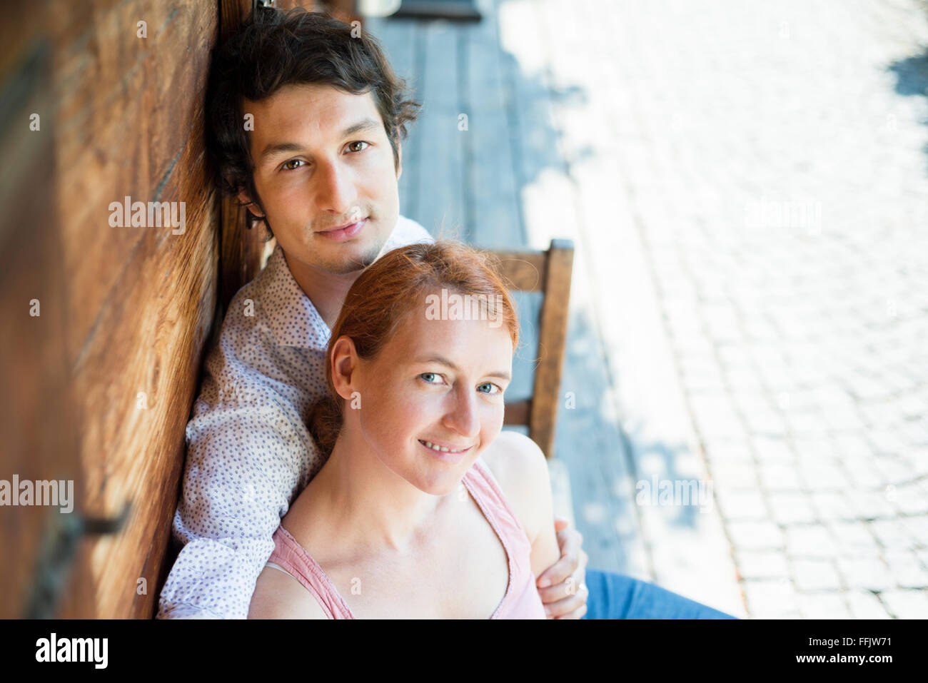 Portrait of happy couple looking at camera - Stock Image