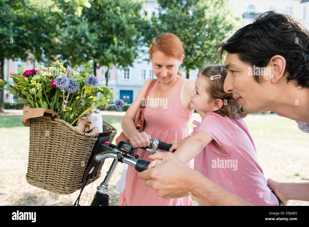 Family with two children and bicycle - Stock Image