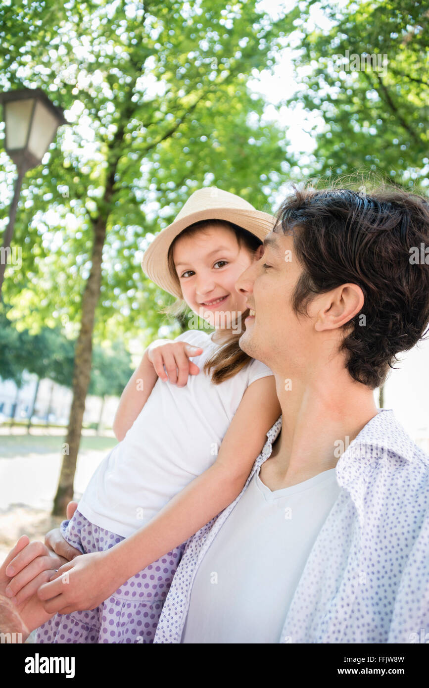 Portrait of father and daughter outdoors - Stock Image