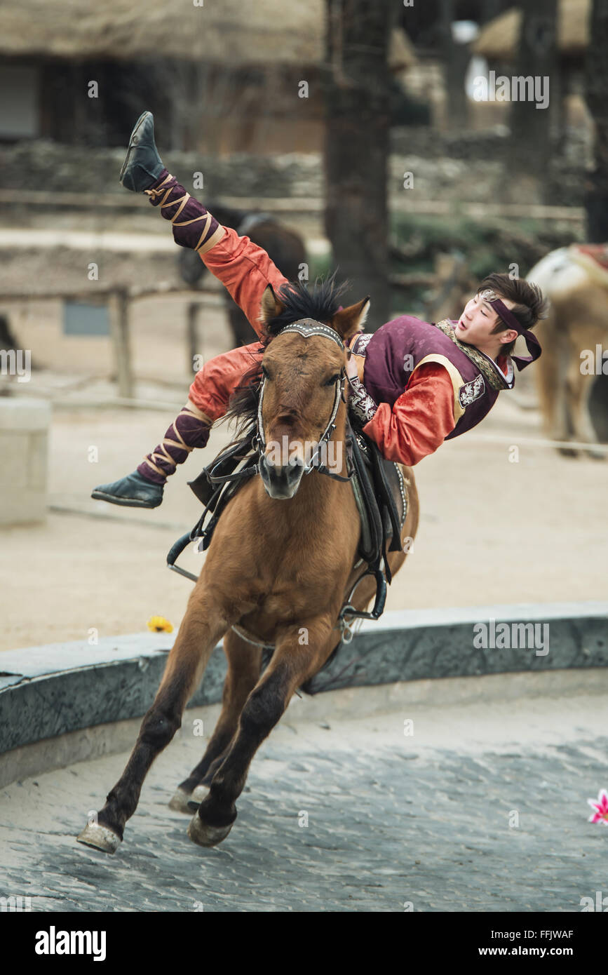 Seoul, South Korea - January 28, 2016: Participant a the Equestrian Feats act, a short acrobatic horseback routine - Stock Image