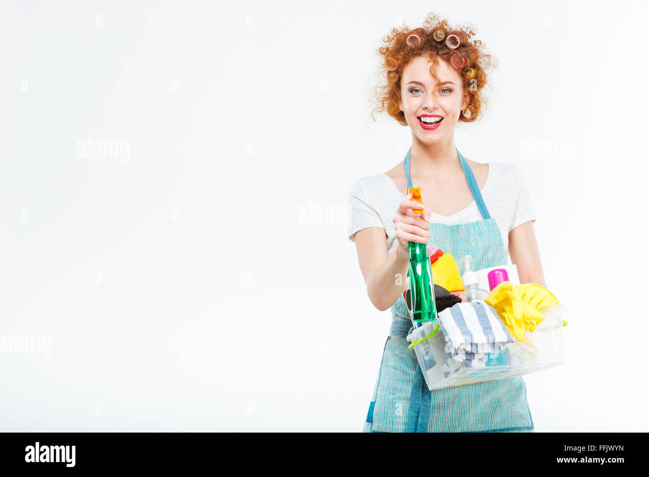 Housewife cleans with detergent spray isolated on a white background - Stock Image