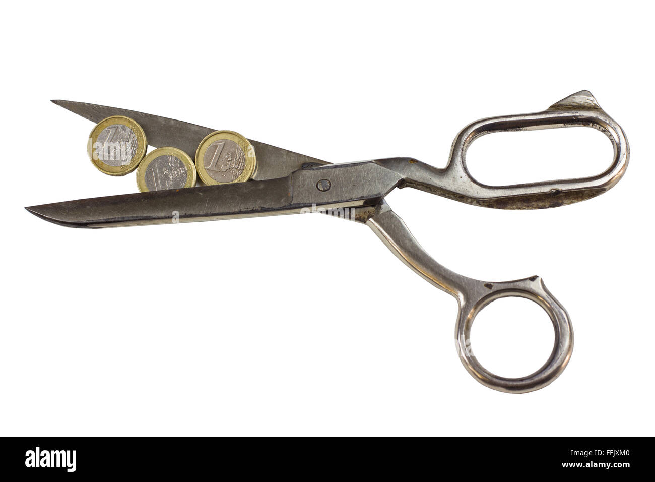 Budget cuts - coins between scissors isolated - Stock Image