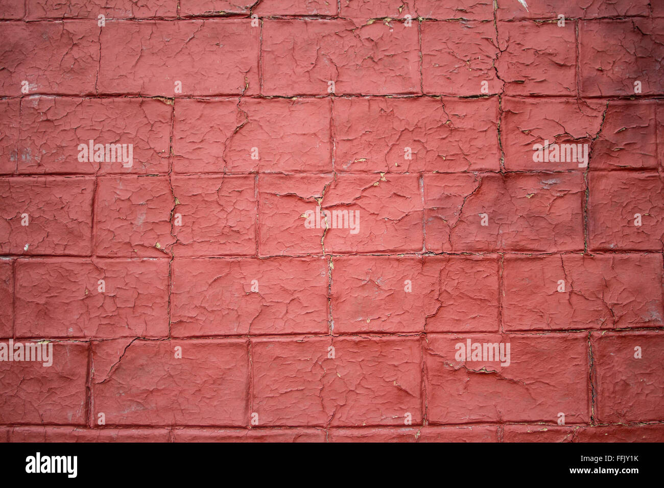 Worn out red brick wall - Stock Image