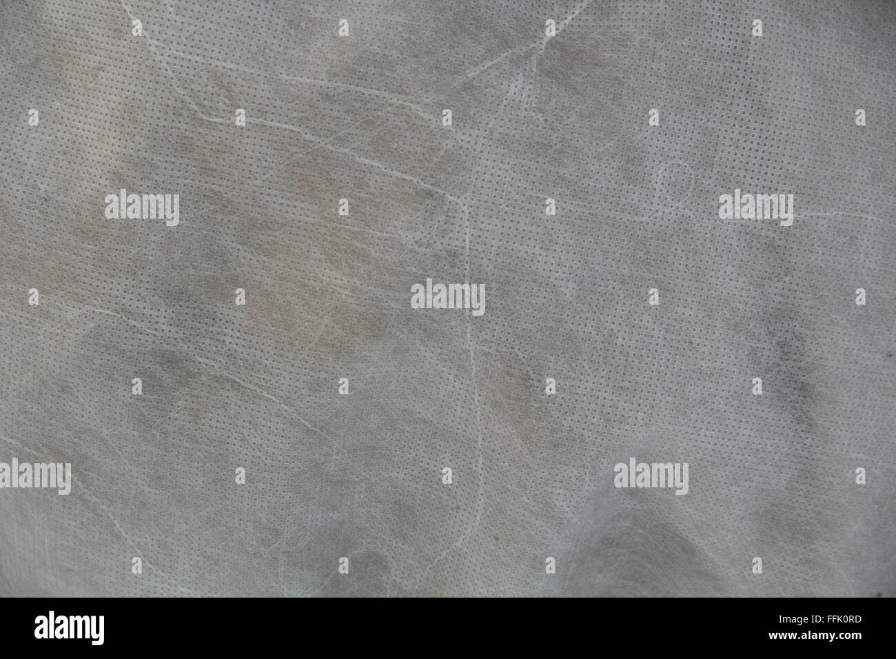 texture of white perforated fabric - Stock Image