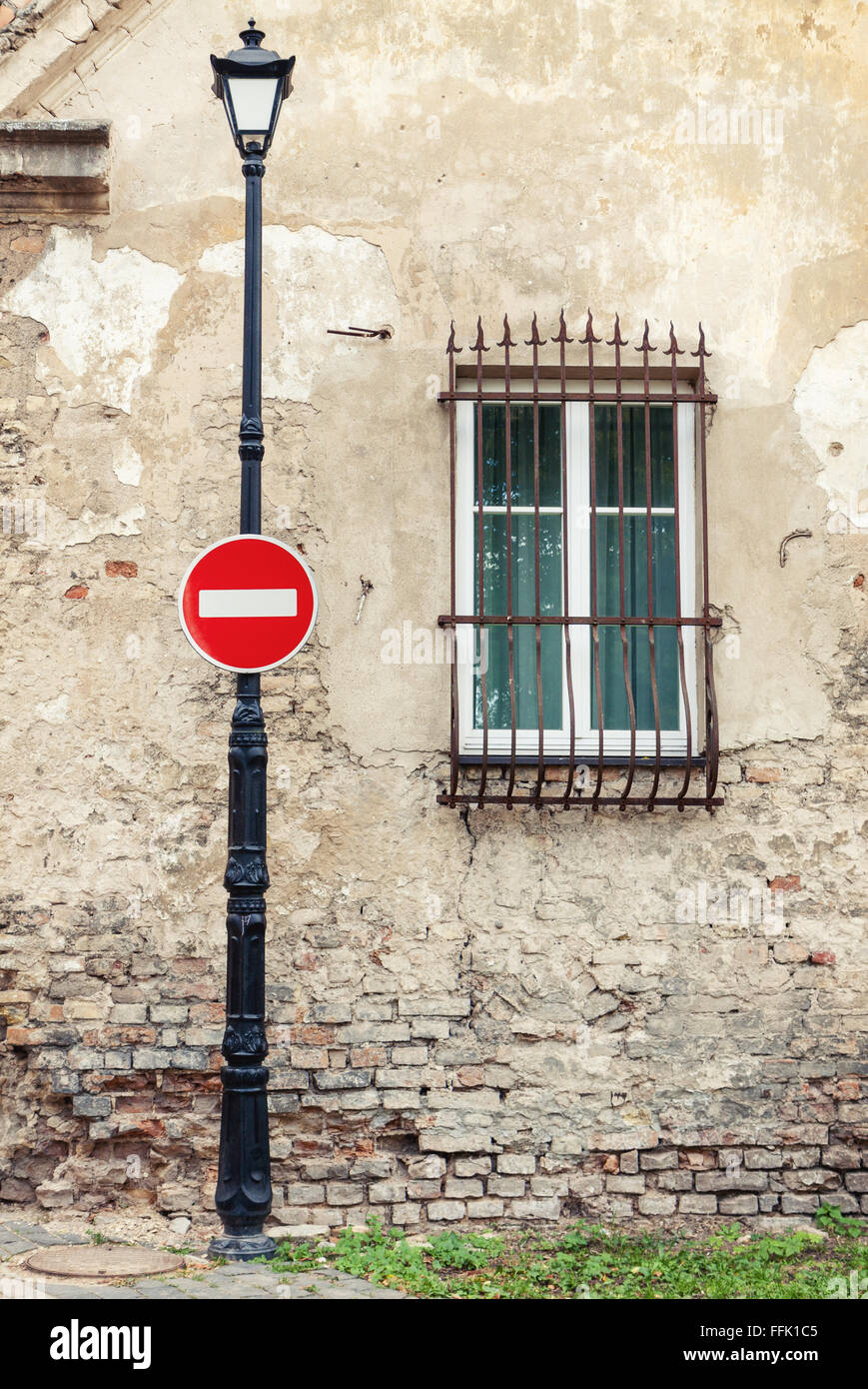No entry road sign on street lamp post - Stock Image