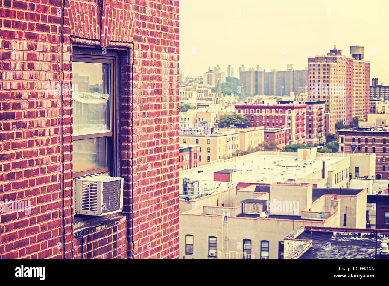 Vintage toned window with external air conditioner unit, Harlem, USA. - Stock Image