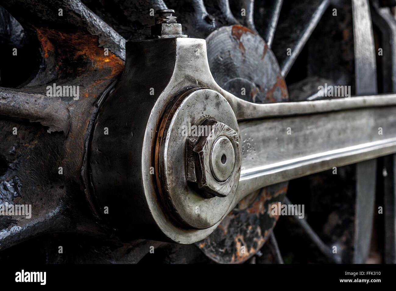 A detailed photograph showing close up view of vintage locomotive drive wheels and drive shafts - Stock Image