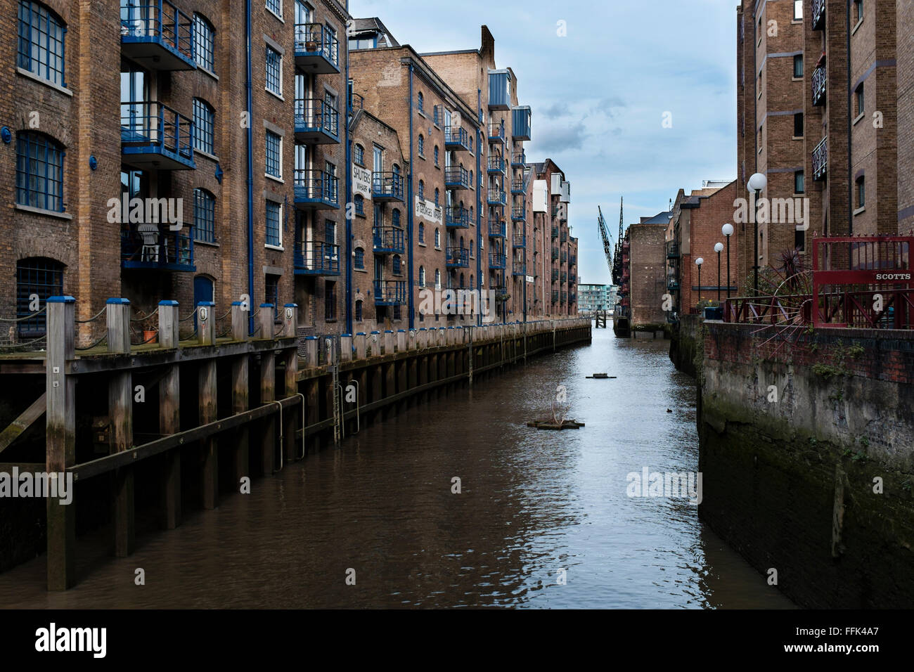 The ancient River Neckinger as it enters the River Thames between Shad Thames and the area previously known as Jacobs - Stock Image