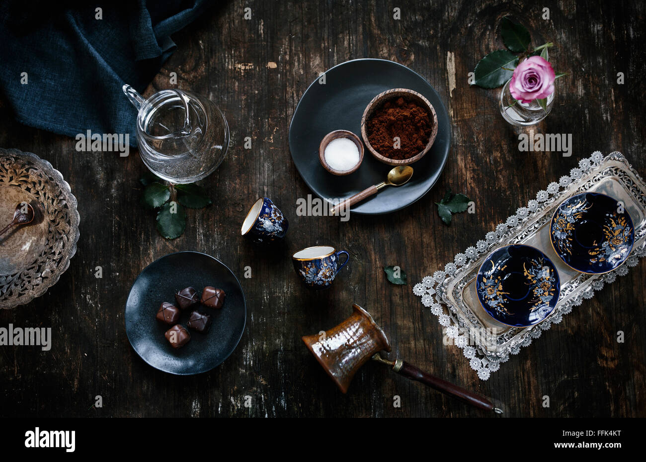 Ingredients for Turkish Coffee (coffee, sugar, water), coffee cups and traditional coffee pot are displayed on a - Stock Image