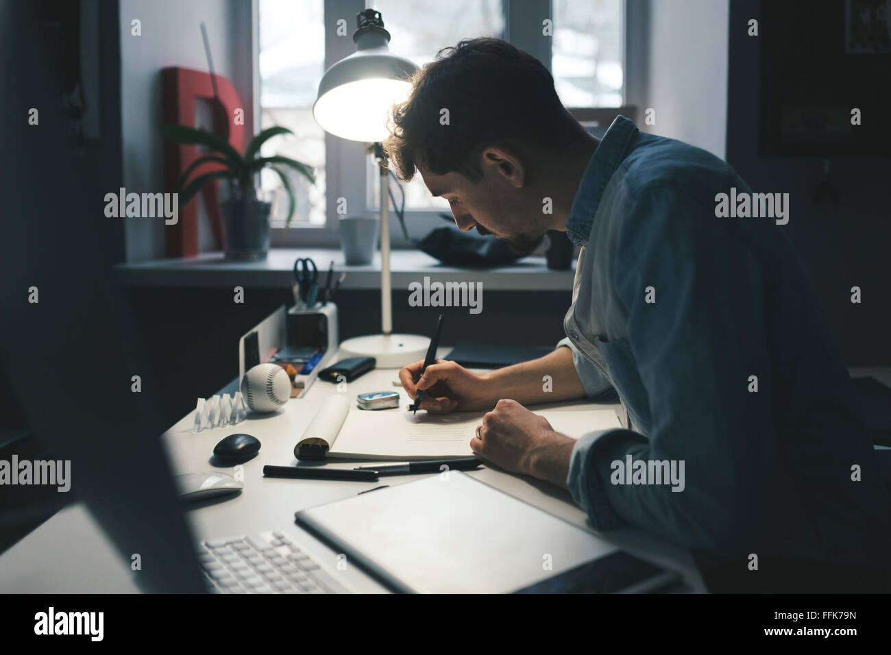 Designer at work in office - Stock Image