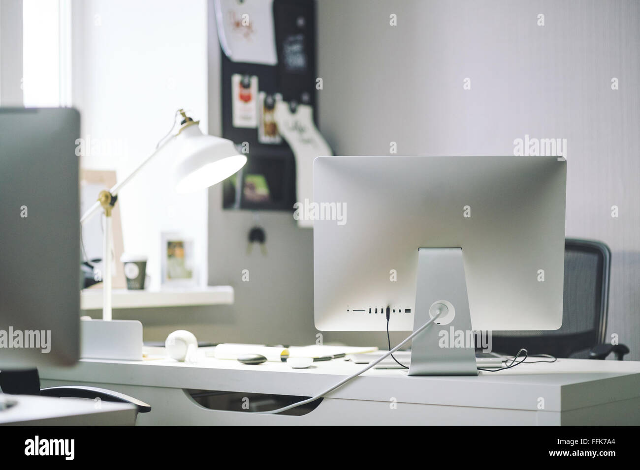 Front view ofcomfortable working place in office - Stock Image