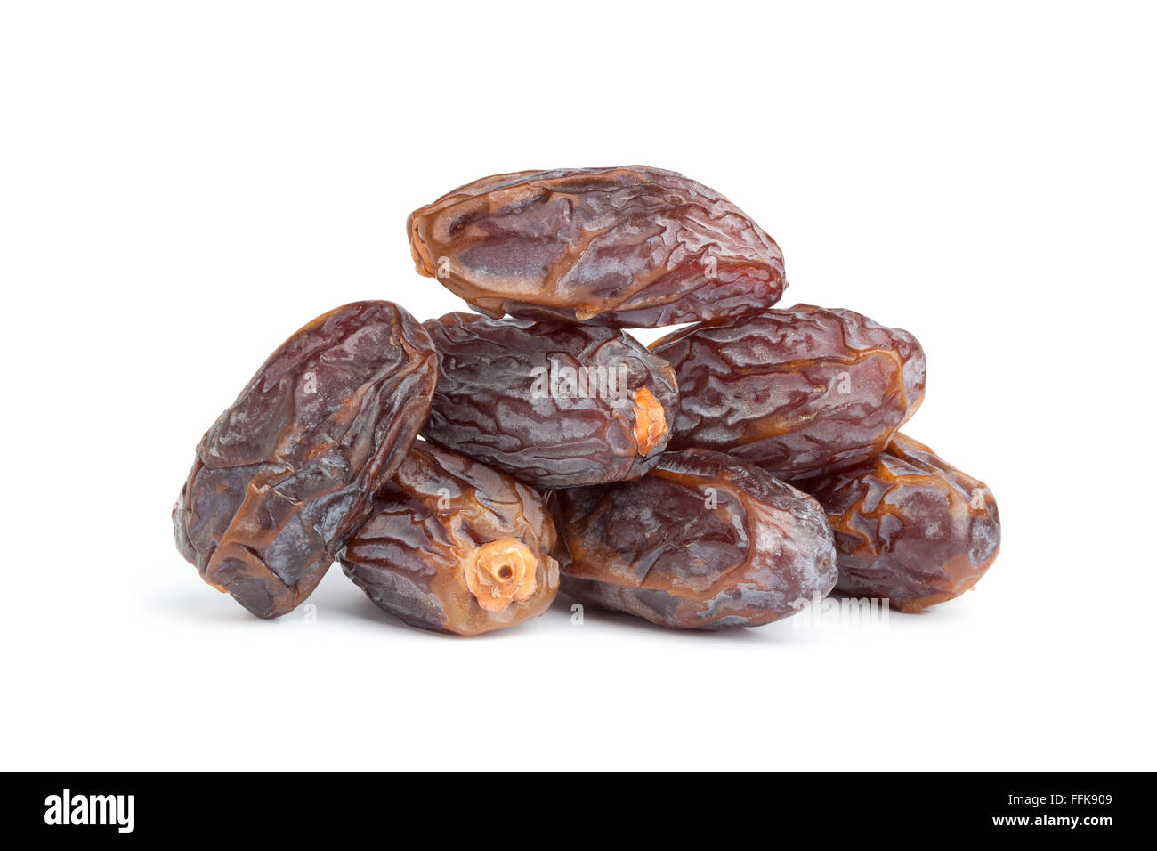 Heap of whole dried dates on white background - Stock Image