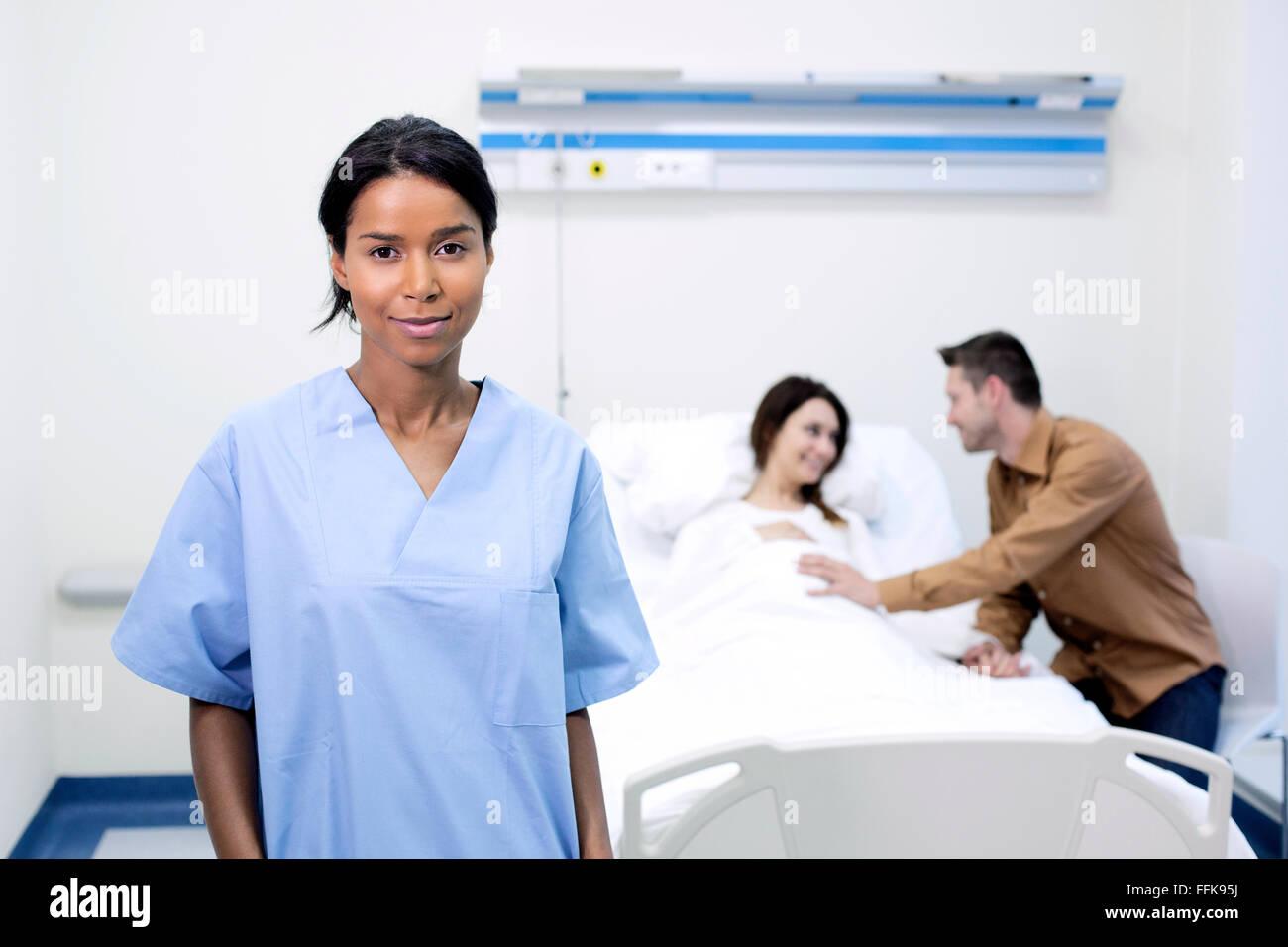 Portrait of nurse in sick room of hospital - Stock Image