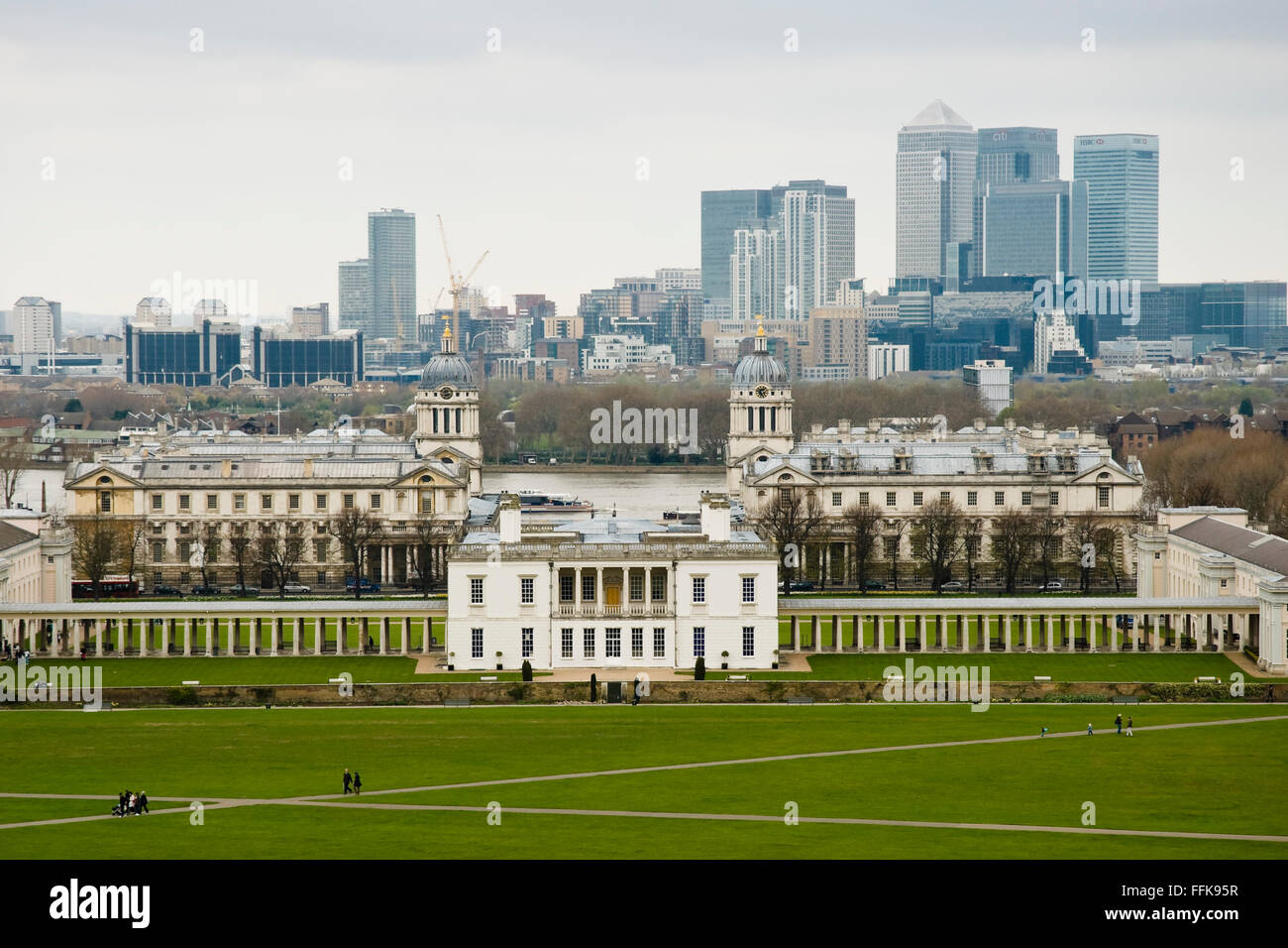 View from Greenwich Park towards the National Maritime Museum, Docklands and Canary Wharf, London, England, UK - Stock Image