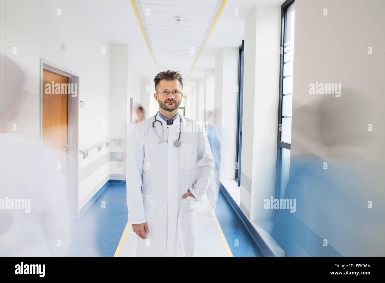 Doctor standing in corridor of medical clinic - Stock Image