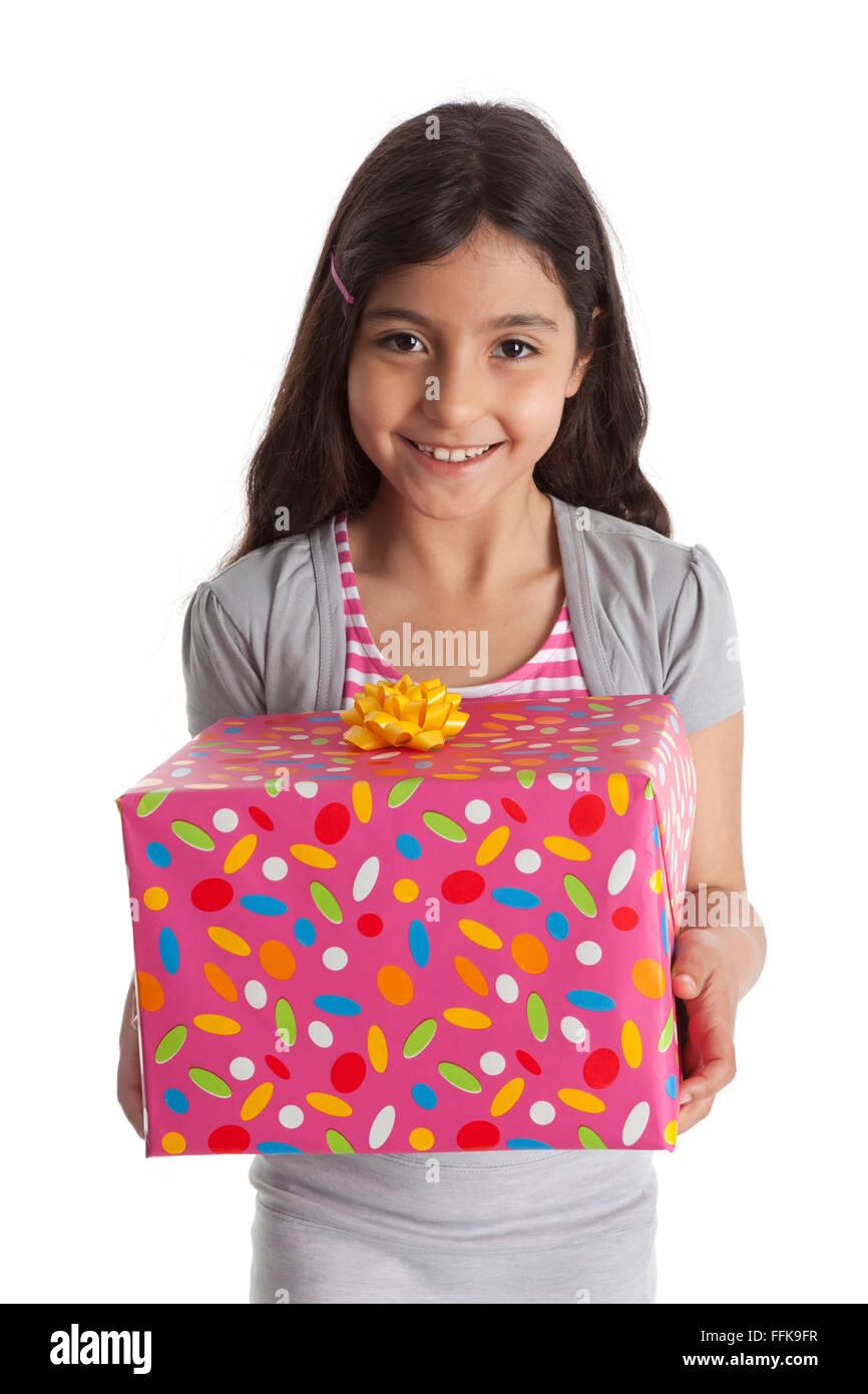 Happy girl with a a present on white background - Stock Image