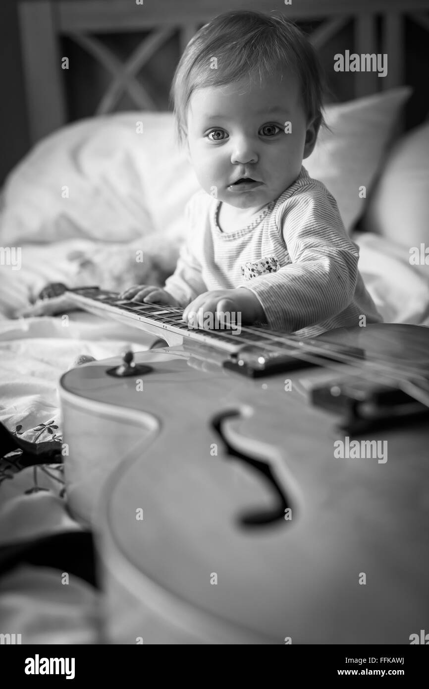 Black And White Photograph Of A Beautiful Cute Baby Girl On A Bed Stock Photo Alamy