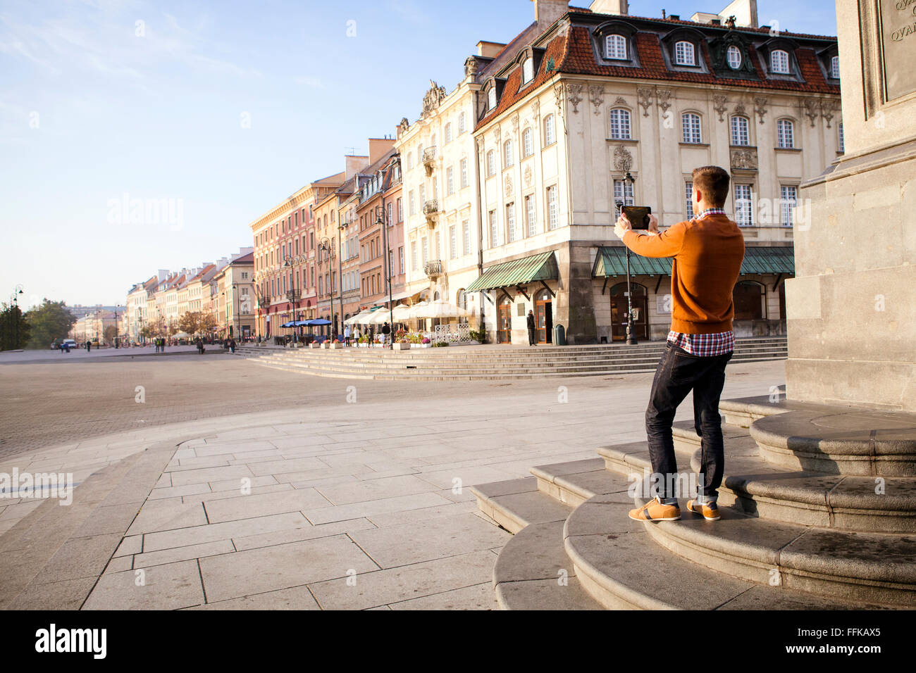 Mid adult man on a city break taking a picture - Stock Image