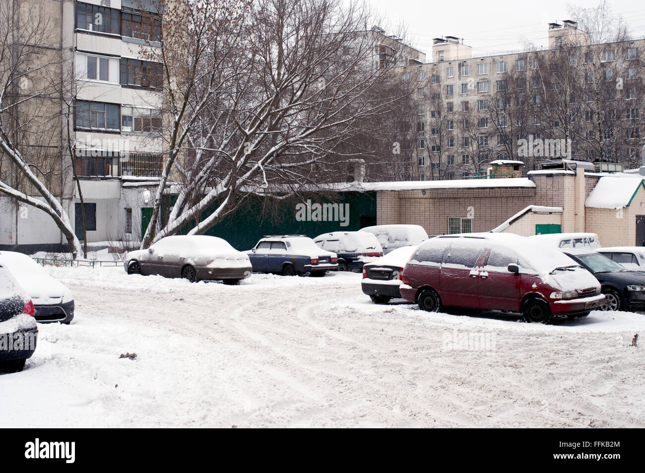 Parked cars in Moscow in Russian Federation during winter - Stock Image