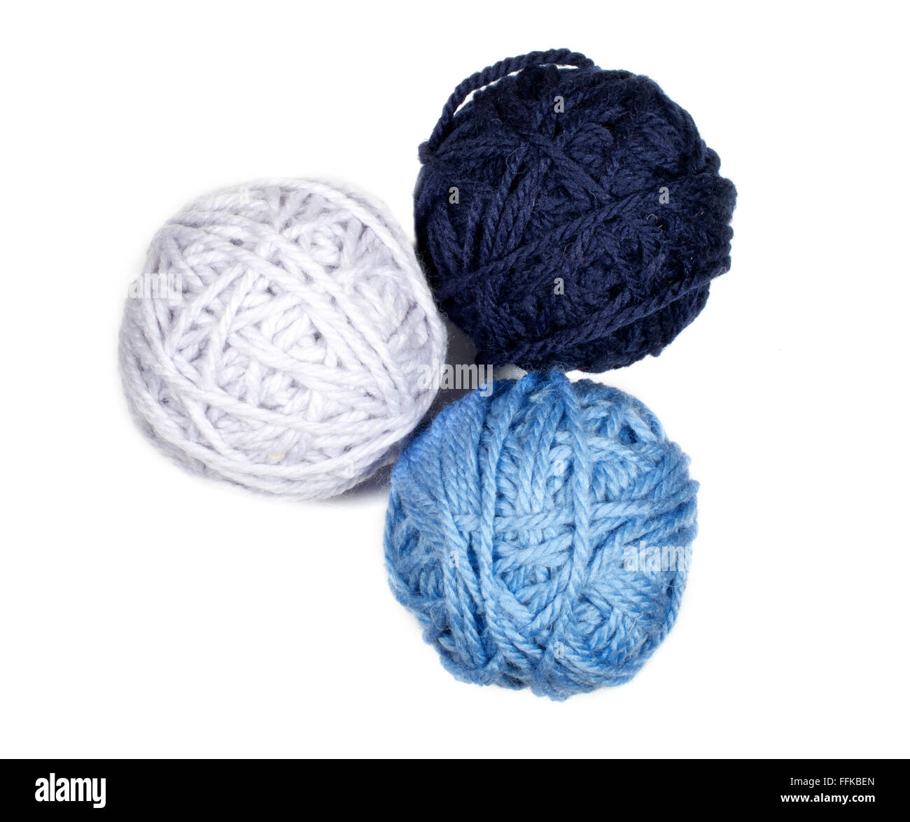 Isolated three skeins in blue over white background macro - Stock Image