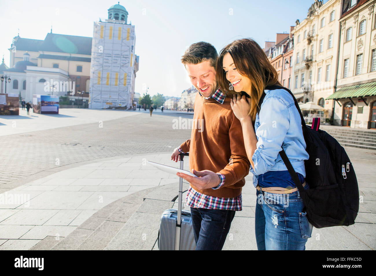 Mid adult couple on a city break using digital tablet Stock Photo