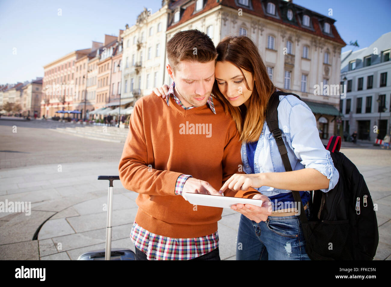 Mid adult couple on a city break using digital tablet - Stock Image