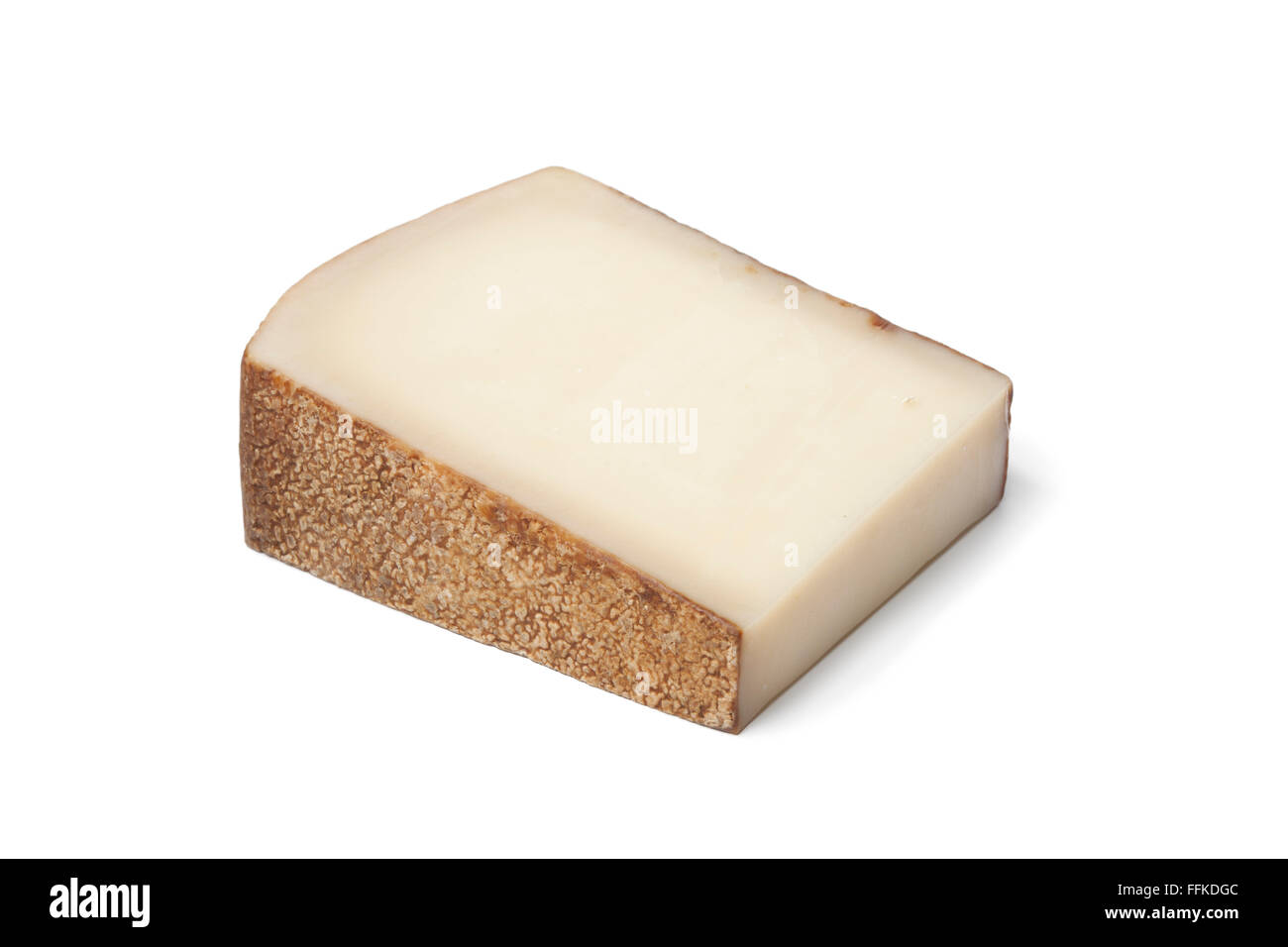 Piece of Swiss Gruyere cheese on white background - Stock Image