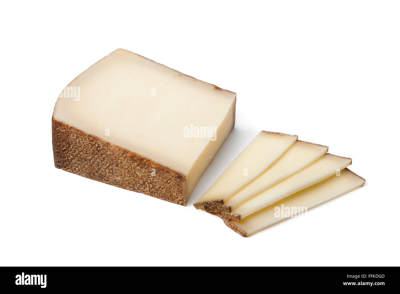 Piece of Swiss Gruyere cheese and slices on white background - Stock Image