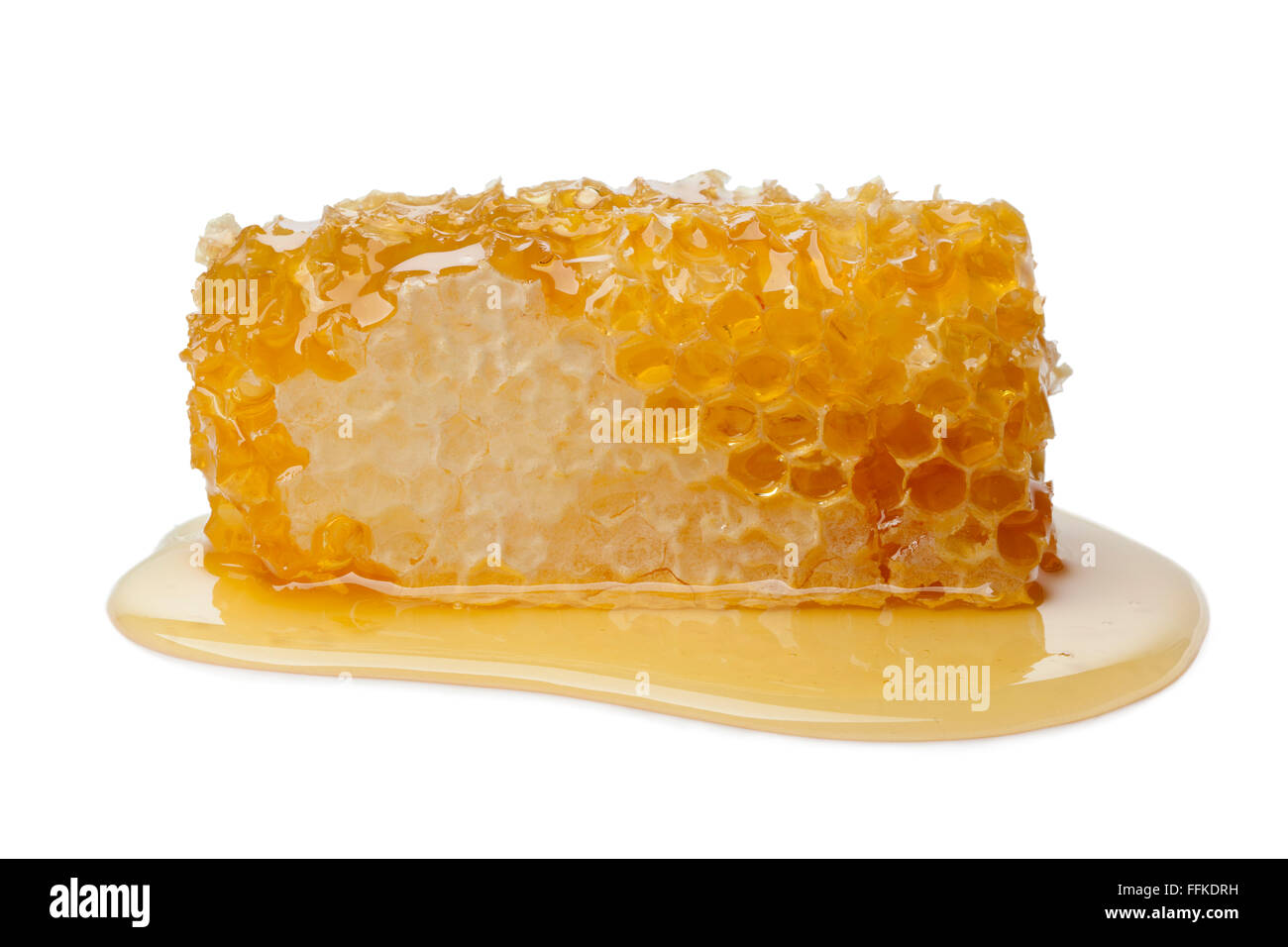 Honeycomb and honey on white background - Stock Image